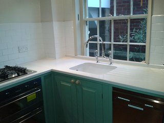 Kitchen includes gas hob, electric oven and dishwasher