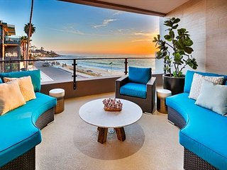 Luxurious new oceanfront condo, steps from the beach, walk to restaurants!
