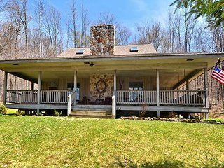 Dancing Bear Lodge is in a wooded setting with large wrap around porch