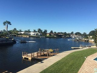 Wonderful canal front home with its own beach bar and heated pool!