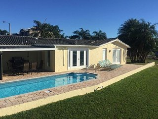 Wonderful canal front home with its own beach bar and heated pool! Come Relax