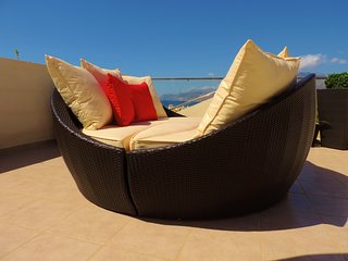 Day bed to relax on in the day or star gaze at night.