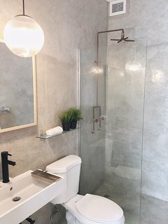 master bath with walk-in shower and custom-designed shower head