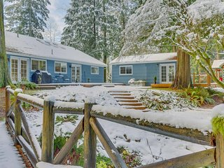 Adorable creekside home w/ updated amenities, cozy fireplace, deck, & gas grill!
