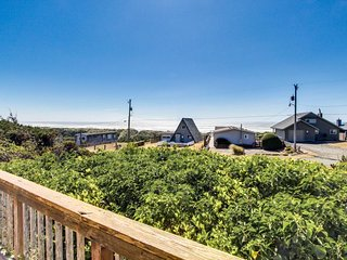 Unique cottage boasts oceanfront location & private balcony