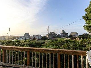 Unique cottage boasts oceanfront location & private balcony