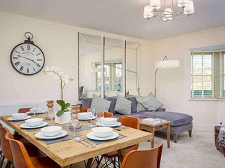 The stylish dining table comfortably seats eight