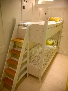 Bunkroom with full length beds, great for kids and adults alike.
