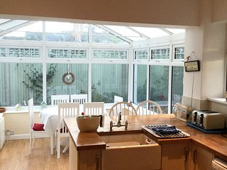 2 dining tables, one in lounge area and one in conservatory. Can be moved together for large parties