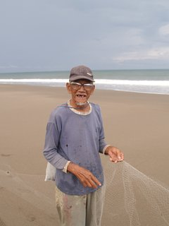 Traditional fishing on the beach.'Selamat Bapak'..Good luck father!