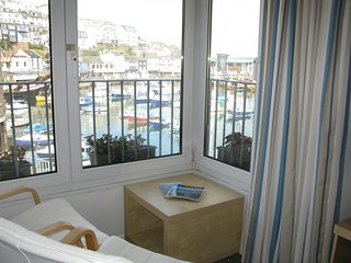 Cottage rental alongside the quay in Brixham Harbour with parking.