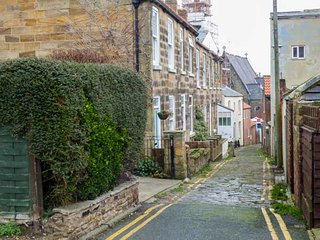 TENBY, three bedrooms, woodburner, enclosed patios, off road parking, in Whitby,