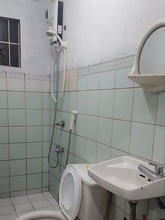 Bathroom is equipped with a shower heater