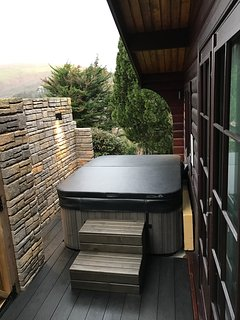 Hot tub in private walled area, with new composite decking.