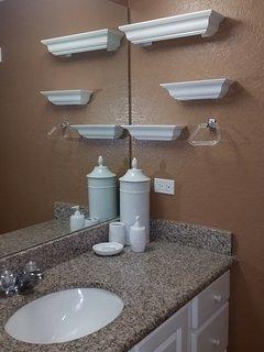 Granite counters in the main floor bathroom.