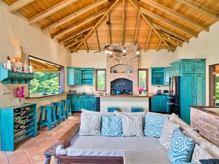 beautiful living room/kitchen with indoor outdoor bar and island.