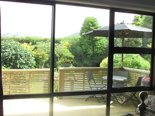 View out of your room showing the private deck and garden