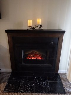 Electric heatless fireplace w/ remote. LED candles w/ remote.