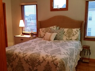 Master bedroom with queen bed. Large closets