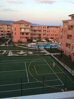 Pool and tennis court view from the balcony on the living/bedroom area.