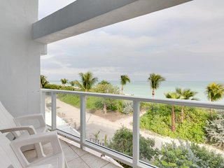 Stylish beachfront condo w/ ocean views, shared pool, & free valet parking