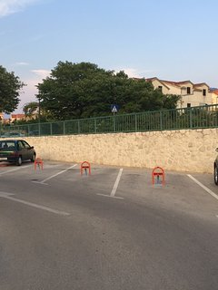 2 parking spots next to the green car are reserved for the villa guests.
