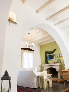 Traditional arch that separates dining area and living room