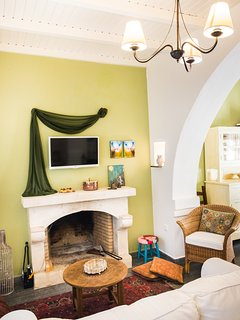 Living room with white stone fireplace