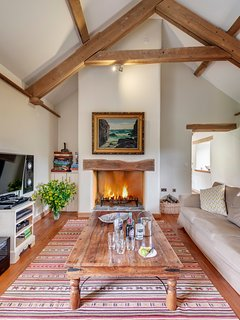 Living room with open fire, TV with full Sky package and x-box
