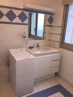 Bathroom (washing machine and hairdryer)