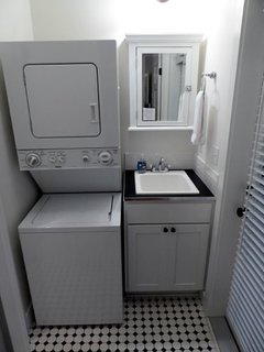 Washer and dryer tucked into the first of two bathrooms