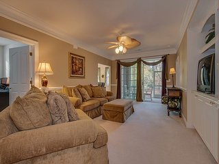 Luxurious 1st floor golf villa, 2.6 miles from the beach with community pool.
