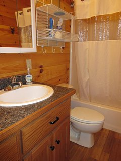 Bathroom with medicine cabinet, storage, and a full tub with shower.  All bath linens new in 2017!