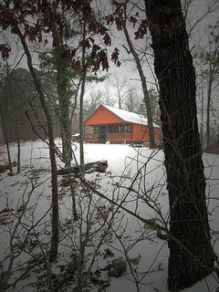 A Hasty Getaway nestled in the forest covered by snow.  The area is great all four seasons!