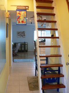 Entry hallway and stairs to loft
