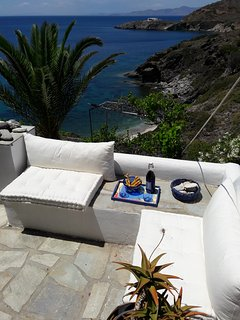 Relax with some wine and enjoy the mesmerizing Aegean sea view