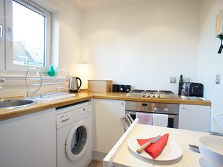 The kitchen is bright and well equipped with fridge/freezer, oven & gas hob and washing machine