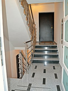 Stairwell to the basement and upper apartments.