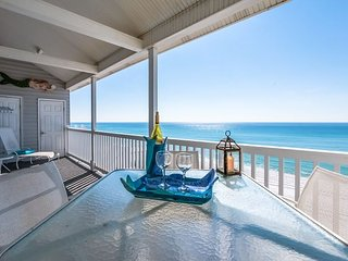 30A Gulf front penthouse with private beach,loft,fireplace, and beach service