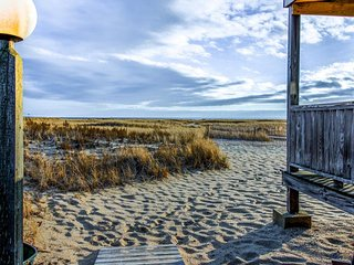 Classic waterfront Cape Cod condo next to the beach w/ deck & grill