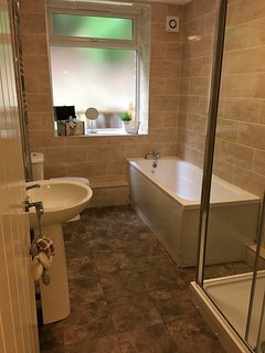 large family bathroom with bath and double shower