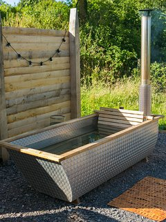 The wood-fired hot-tub is Swedish - no chemicals, just water and fire required...