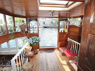 Amstel Houseboat A359 apartment in Canal Belt with WiFi & private terrace.