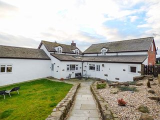 UPPER CAMNANT BARN, barn conversion, off road parking, two dogs, hot tub, Llanbi