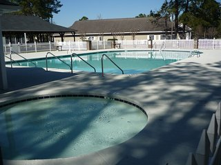 Charming 2 Bed Condo 6 miles to Beach quiet wooded area outdoor pool playground