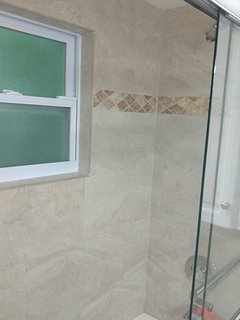 New Custom Bathroom. Beautiful Custom tile shower with bathtub.
