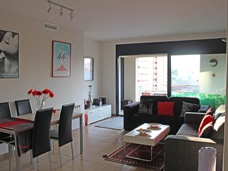 Bright, airy living room looking out onto a spacious balcony...