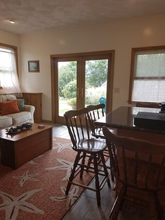Relax in the 2nd living area downstairs, with easy access to backyard fun.