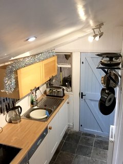 Well lit and equipped galley kitchen with access to rear courtyard.