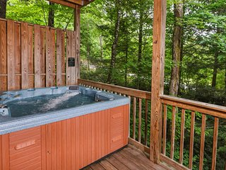 Relax in the hot tub among the trees
